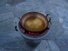 brass wok on tao burner