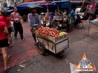 Pushing a Fruit Cart Through a Busy Market