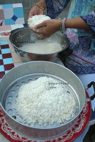 Thai Street Vendor for Thai Fermented Sweet Rice Dessert, 'Khao Mahk' - Step 3<br>Set rice into stacked steamer (line with cheesecloth for best results) or use sticky rice steamer.