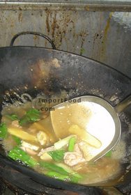 Thai Street Vendor for Thai-Style Wide Noodles In Thick Sauce, 'Kuaytiao Lad Na'