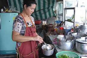 Thai Street Vendor for Thai Spicy Ground Chicken and Toasted Rice, 'Larb Gai'