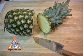 Peel and Slice Fresh Pineapple - Cut the top off