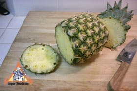 Peel and Slice Fresh Pineapple - Cut the bottom off