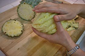 Peel and Slice Fresh Pineapple - With some salt the palm of each hand, rub.