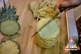 Peel and Slice Fresh Pineapple - Avoiding the center core, slice downward