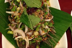 Larb over fried fish in Bangkok