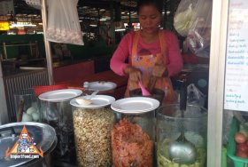 Som Tum Vendor with Tall Glass Jars