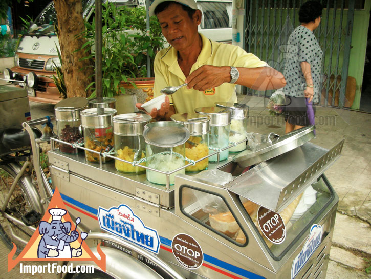 Thai Street Vendor Offers Candied Ice Cream From A Bicycle