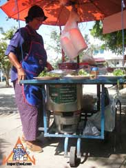 thai street vendor charcoal burner
