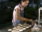 Street Vendor Prepares Khanom Buang