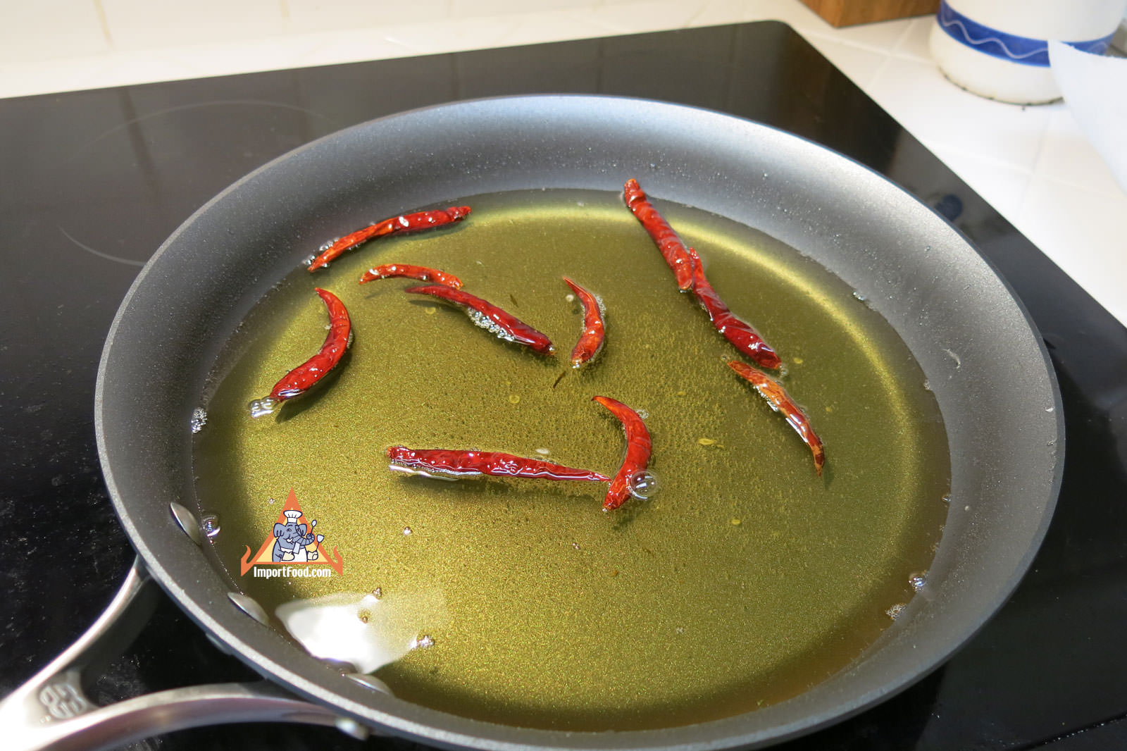 Fry whole dried chiles for garnish