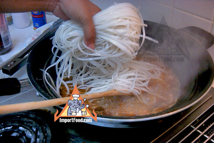 Adding rice stick noodles