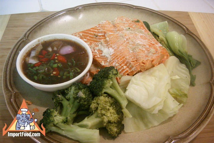 Steamed fresh fish and vegetables thai style with dipping sauce