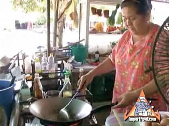 Street Vendor Prepares Two Variations of Pad Thai