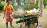 Thai Street Vendor Prepares Charcoal Barbecue Traditional Sausage