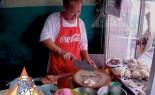 Thai Street Vendor Offers Khao Mun Gai from a Shophouse Cart