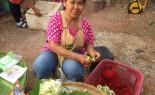 Market Vendor Prepares Sesbania Flower