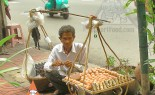 Thai Street Vendor Offers Sticky Rice Wrapped in Banana Leaves, Kao Neeo Khai Ping