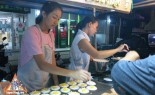 Thai Street Vendor Prepares Thai-Style Pancakes, Khanom Buang