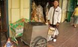 Thai Street Vendor Offers Yakult Sour Milk from a Push Cart