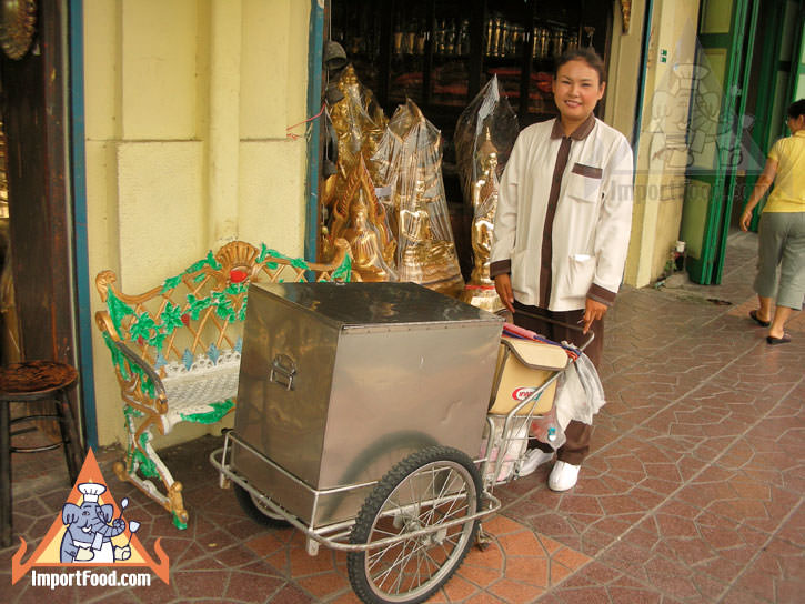Thai Street Vendor Offers Yakult Sour Milk from a Push Cart
