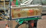 Thai Street Vendor Offers Assorted Deep-Fried Meatballs from a Push Cart