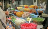 Bangkok Sidewalk Vendor Nong Amp Offers Assorted Thai Sweets and Appetizers