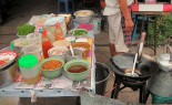 Thai Street Vendor Prepares Thai-Style Stir-Fried Noodles,