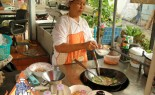 Thai Street Vendor Prepares Thai-Style Noodles in Gravy, Ladna
