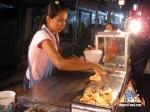 street-vendor-prepares-khanom-buang-08.jpg