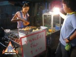 street-vendor-prepares-khanom-buang-09.jpg