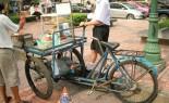 Thai Street Vendor prepares Barbecue Pork, Chicken and Beef Skewers