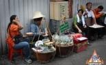 Thai Street Vendor hand wrapping Miang Kahm